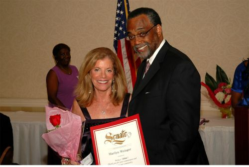 Marilyn receiving SHeroes award from Senator Curren D. Price