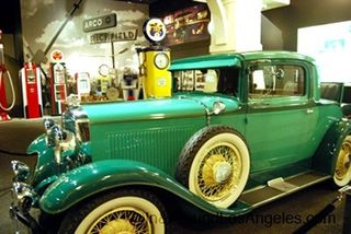Green coupe in garage